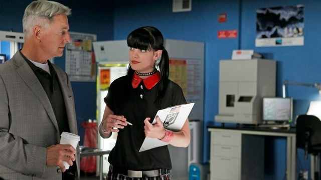 NCIS Forensic scientist Abby Sciuto talking to NCIS Special Agent Gibbs in her lab