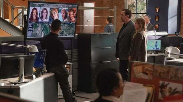 NCIS Special Agents looking at a plasma screen to learn more about a case