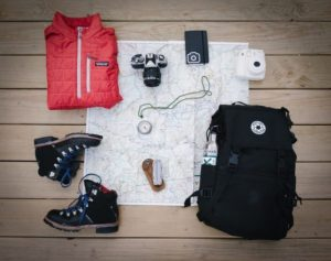 Walking boots, map, camera, compass and other outdoor equipment