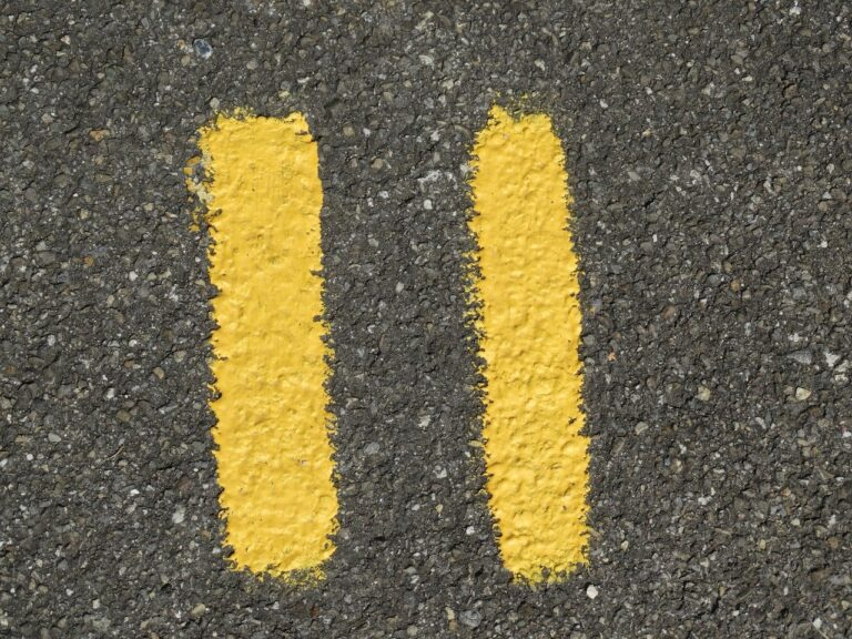 Number 11 written on tarmac in the stlyle of double yellow lines