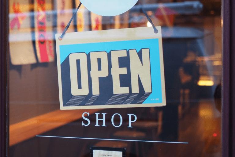 Shop door with Open swing sign on it