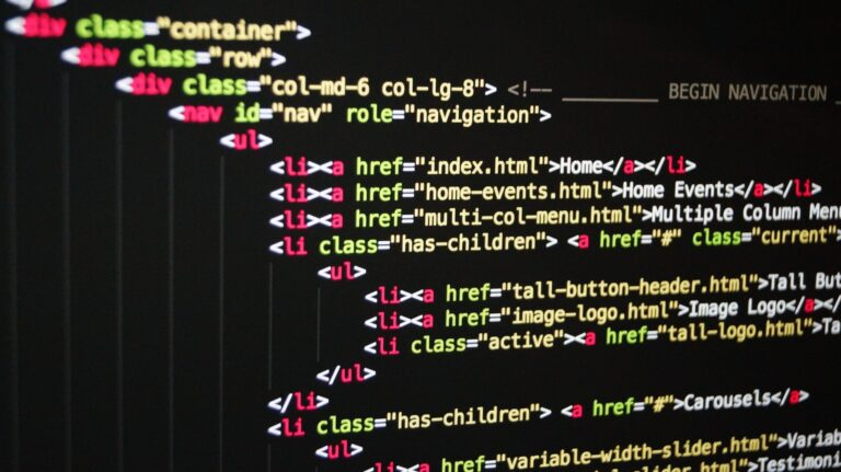 A page of website code on a black background, signifying website design and development
